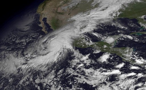 "This NOAA image of Hurricane Patricia was taken by the GOES East satellite at 1445Z. Monster Hurricane Patricia rumbled toward Mexico's Pacific coast on Friday, growing into the strongest storm on record in the Western Hemisphere as the country braced for a potential catastrophe. Authorities relocated some villagers, closed ports and schools in several states, and urged tourists to cancel trips as the hurricane headed toward landfall in the western state of Jalisco later Friday.""No hurricane of this magnitude has ever affected the Mexican Pacific,"" President Enrique Pena Nieto wrote on Twitter. AFP PHOTO/NOAA = RESTRICTED TO EDITORIAL USE - MANDATORY CREDIT ""AFP PHOTO /NOAA"" - NO MARKETING NO ADVERTISING CAMPAIGNS - DISTRIBUTED AS A SERVICE TO CLIENTS ="