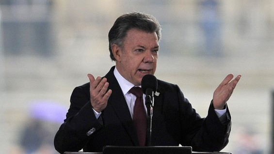"Colombia's President Juan Manuel Santos speaks during a ceremony for the 30th anniversary of the 1985 siege of the Palace of Justice by the M-19 guerrilla and its bloody recovery by the Army, on November 6, 2015, in the Palace of Justice in Bogota, Colombia. Santos apologized in a ""public act of acknowledgment of international responsibility"" of the State for the disappearance of people during the bloody recovery by the Army, accepting a measure of reparation ordered last year by the Inter-American Court of Human Rights (IACHR). AFP PHOTO/GUILLERMO LEGARIA"