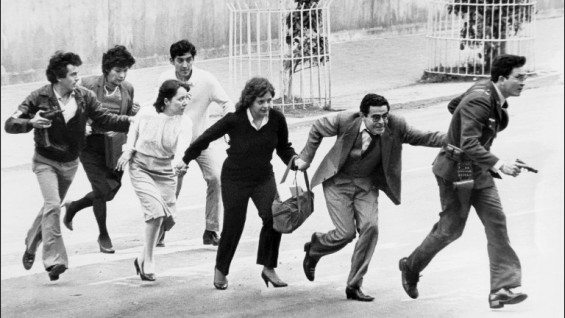 Employees of the Palace of Justice in Bogota leave their office, 06 November 1985, under police protection, after a M19 movement guerillas commando occupied the building detaining 10 magistrates of the Supreme Court and State Council and over a 100 people. Government troops attacked on 07 November killing more than 100 people including 11 justices. Following this event, paramilitary death squads were formed to execute Government opponents.